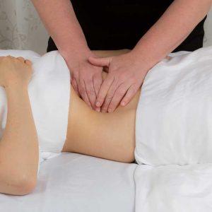 Two hands massaging a client